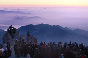 Sun Rise Prints - Visitors To Mt. Tai Crowd Its Peak Print by O. Louis Mazzatenta