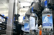 Bottle. Bottling Framed Prints - Vodka Bottling Machine Framed Print by Ria Novosti