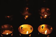 Crosses Photo Prints - Votives Burn In A Darkened Church Print by Raul Touzon