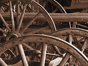 Wood Wheel Prints - Wagon Wheels Print by Andrea Arnold