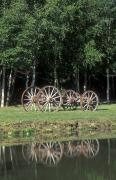Wagons Posters - Wagon Wheels Reflecting In A Pond Poster by Rich Reid