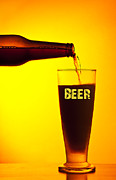 Waiter Photos - Waiter pouring dark beer by Anna Omelchenko