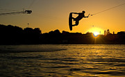Mid Air Posters - Wakeboarder At Sunset Poster by Andreas Mohaupt