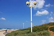 Lamp Post Prints - walkway along the Tel Aviv beach Print by Zalman Lazkowicz