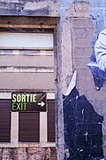 Exit Sign Prints - Wall with exit signs in French and English Print by Sami Sarkis