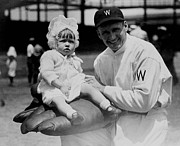 Washington Baseball Prints - Walter Johnson holding a baby - c 1924 Print by International  Images