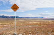Bleak Desert Framed Prints - Warning Sign at Desert Rest Stop Framed Print by Thom Gourley/Flatbread Images, LLC