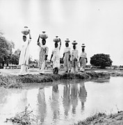 Balance In Life Photos - Water Carriers by Three Lions