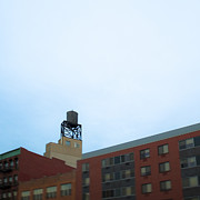 Roofline Prints - Water Tower on Roof of Building Print by Eddy Joaquim
