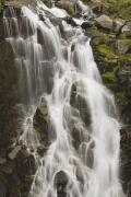 Ground Level View Posters - Waterfall Flowing Over Rocks Poster by Craig Tuttle
