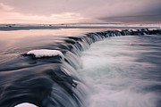 Flowing Water Prints - Waterfall In Winter During Sunset Print by Ingólfur Bjargmundsson