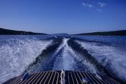 Finger Lakes Photos - Waves Left In The Wake Of A Boat by Kenneth Garrett