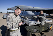 Guided Missiles Framed Prints - Weapons Loaders Inspect An Agm-158 Framed Print by HIGH-G Productions