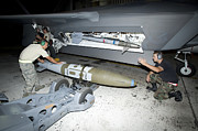 Kneeling Prints - Weapons Loaders Load A Gbu-32 Jdam Print by HIGH-G Productions