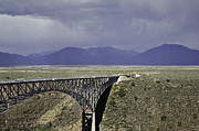 Taos Posters - Weather at the Rio Grande Gorge Bridge Poster by Melany Sarafis