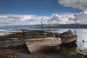 Water Vessels Posters - Weathered Boats Abandoned At The Waters Poster by John Short