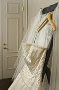 Clothes Hanger Framed Prints - Wedding Dress Framed Print by Ned Frisk