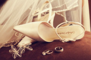 Announcement Prints - Wedding shoes with veil and rings on velvet chair Print by Sandra Cunningham