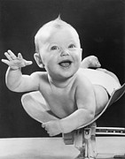 1940-1949 Prints - Weighing Baby Print by Fpg