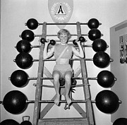 Mid Adult Women Photo Posters - Weightlifting Woman Poster by Evans