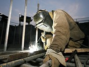 Reinforced Framed Prints - Welder Working On A New Bridge Framed Print by Ria Novosti