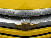 Samuel Sheats Prints - Wet Chevrolet Print by Samuel Sheats