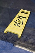 Caution Prints - Wet Floor Sign In Puddle Print by Mark Williamson