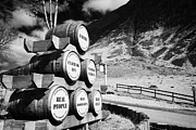 Glen Coe Prints - Whisky Barrels Outside The Clachaig Inn Glencoe Highlands Scotland Uk Print by Joe Fox