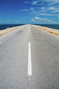 Road Marking Posters - White dividing line marking a road in Cuba Poster by Sami Sarkis
