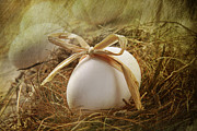 Easter Egg Prints - White egg with straw bow in nest Print by Sandra Cunningham