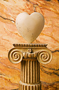 Warmth Prints - White stone heart on pedestal Print by Garry Gay