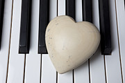 Heart Stone Posters - White Stone Heart On Piano Keys Poster by Garry Gay