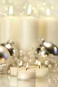 December Prints - White votive candles  Print by Sandra Cunningham