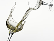 Champagne Posters - White Wine Pouring From One Glass Into Another Poster by Andy Roberts