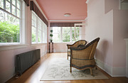 Flooring Prints - Wicker Chairs in a Sun Room Print by Jetta Productions, Inc