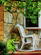 Rocking Chairs Photos - Wicker Rocking Chair on Porch by Susan Savad