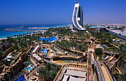 Persian Gulf Countries Framed Prints - Wild Wadi Waterpark Spreads Around The Foot Of The Jumeira Beach Hotel Framed Print by Mark Daffey