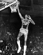 Dunk Photo Framed Prints - Wilt Chamberlain (1936-1996) Framed Print by Granger