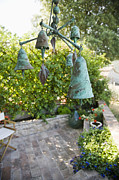 Chimes Photos - Wind Chimes in Garden by Andersen Ross