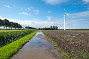 Flevoland Framed Prints - Wind turbine in a field after rain Framed Print by Jan Marijs