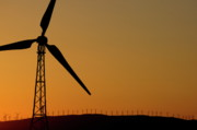 Tarifa Posters - Wind turbine on a ridge at sunset Poster by Sami Sarkis