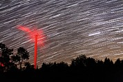 Startrail Photos - Wind Turbine Under Star Trails by Laurent Laveder