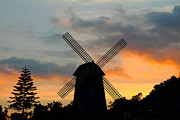 Rotate Posters - Windmill at sunset  Poster by Phalakon Jaisangat