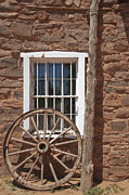 Historic Site Prints - Window in Stone Building With Wagon Wheel Print by Thom Gourley/Flatbread Images, LLC