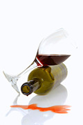 Cabernet Sauvignon Prints - Wine bottle and glass resting on their sides Print by David Smith
