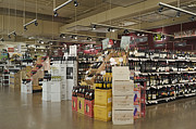 Grocery Store Prints - Wine Section in a Supermarket Print by Robert Pisano