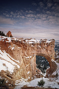 Holes In Sandstone Posters - Winter Snow Covers The Eroded Natural Poster by Gordon Wiltsie