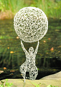 Ball Sculpture Prints - Wire Woman holding a Ball Print by Tommy  Urbans