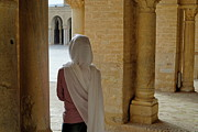 Hijab Framed Prints - Wman wearing veil inside Kairouan Great Mosque Framed Print by Sami Sarkis