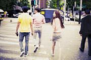 Woman And Korean People Walking Across The Street Print by Setsiri Silapasuwanchai